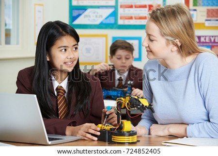 Teacher With Pupils In Science Lesson Studying Robotics #724852405
