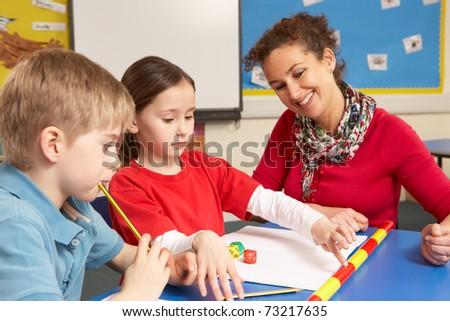 Teacher With School Children In Classroom