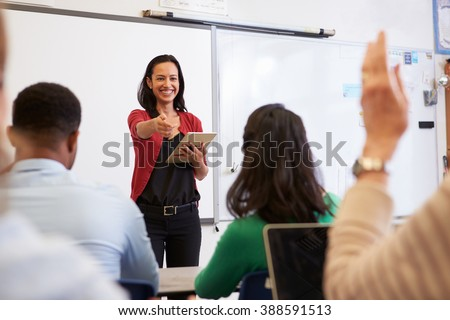 Teacher with tablet and students at an adult education class #388591513