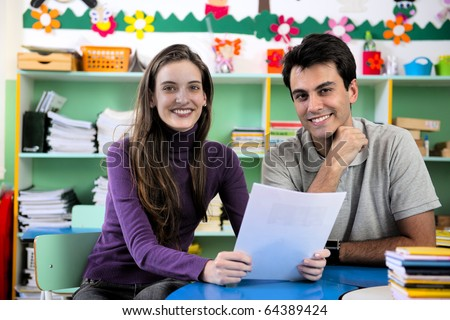 Teachers or teacher and parent having a discussion in classroom