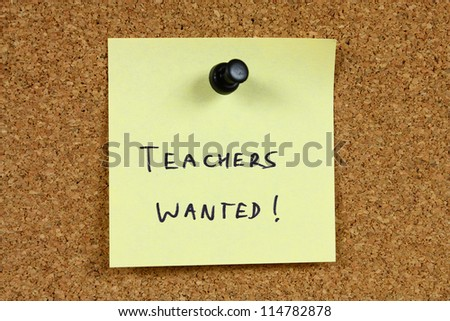Teachers wanted - education career opportunity. Job recruitment. Yellow sticky note pinned to an office notice board.