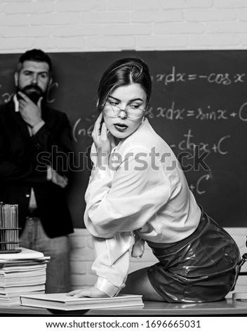 Teaching is her desire. Sensual teacher flirt with student. Sexy woman seduce bearded man in class. Desire drives her back to school. Sparking desire for knowing. Desire and seduction.