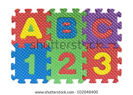 "Teaching kids concept - the letters ""ABC"" and numbers ""123"" spelled with alphabet puzzle pieces isolated on white background"