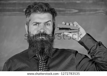 Teaching memorization techniques. Hipster teacher formal wear with neck tie holds stapler. Back to school and studying. Teacher bearded man with pink stapler chalkboard background. Pin it on mind.