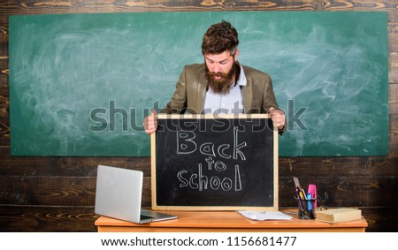 Teaching pupils his professional occupation. Teacher or school principal welcomes inscription back to school. Teacher experienced tutor welcomes new enrollees to begin study and get education. #1156681477