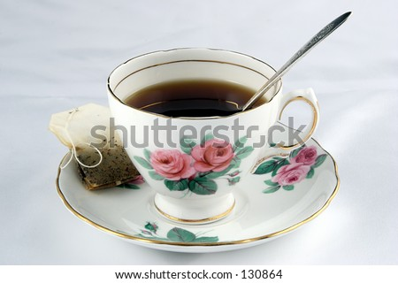 Teacup and saucer with a teabag.