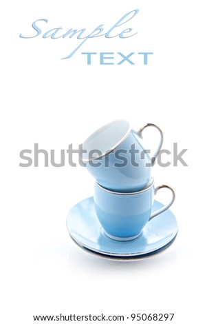 Teacups stacked with space for text on white background