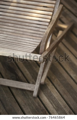 Teak lounge chair on a wooden deck