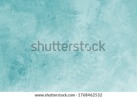 Teal background featuring a painted concrete surface with pastel tiffany blue color. Can be used as background or backdrop.