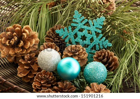 Teal Decorations and Pine Cones Teal holiday decorations with pine cones and fresh cut pine branches.