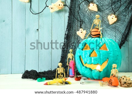 Teal pumpkin Jack O\' Lantern indicates that this place provides allergy free non food treats for Halloween trick or treaters