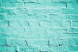 Teal turquoise or aqua mint green brick wall background texture