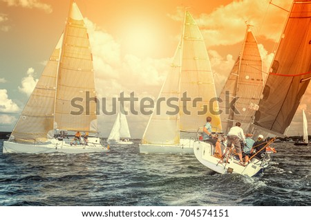 Team athletes participating in the sailing competition - yacht race, regatta. Sailboats. Recreational Water Sports, Extreme Sport Action. Healthy Active Lifestyle. Summer Fun Adventure. Hobby #704574151
