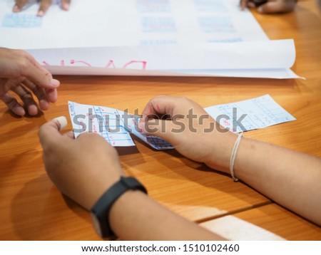 Team brainstorming on flip chart