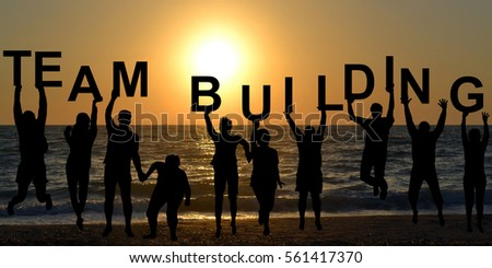 Team building concept with people entertaining on beach