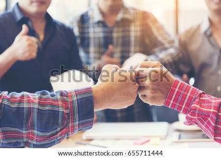 Team Business Partners Giving Fist Bump after complete a deal. Successful Teamwork Partnership in an office. Businessman with hands together. industry business concept