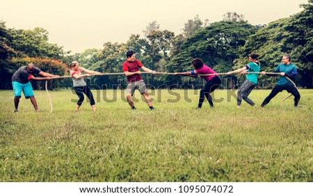 Team competing in tug of war Foto stock ©