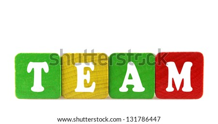 team - isolated text in wooden building blocks