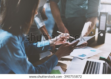 Team job succes. Photo young business managers  working with new startup project in office. Analyze document, plans. Generic design notebook on wood table, papers, documents. Horizontal, blurred #390755872