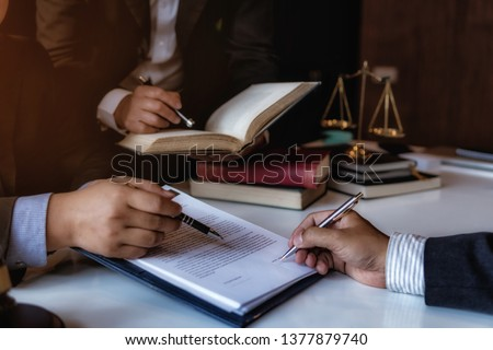 Team lawyers presents to the client for signed contract papers in office. justice and law ,attorney, court judge, concept.