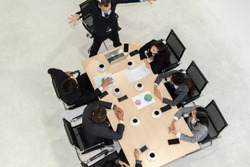 Team leader encourages people in team at meeting table . Executive manager gives command to office workers in group conference . Business teamwork motivation and aspiration concept.