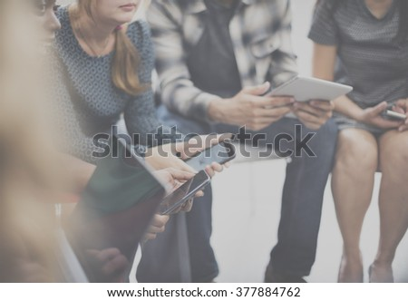 Team Meeting Technology Digital Device Holding Concept - Shutterstock ID 377884762