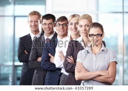 Team members standing on the growth in office