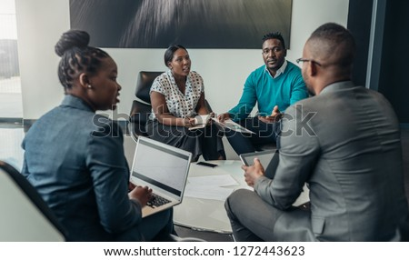 Team of african bussines people debating during a work meeting. Colleagues in serious discussions