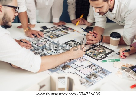 Team of architects working on construction plans #574736635
