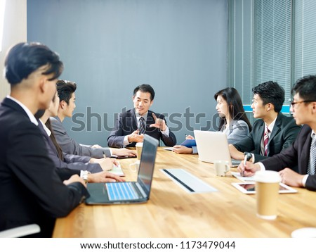 team of asian corporate business people men and women meeting in office. #1173479044