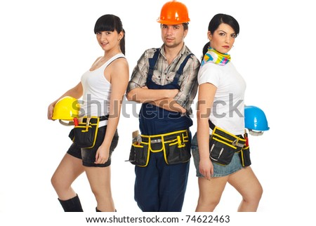 Team of attractive workers ,man in the middle of two sexy workers women holding helmets isolated on white background