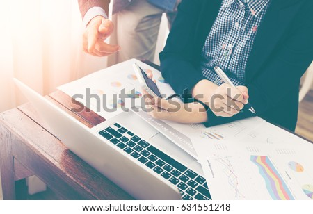 Team of business investment consultant analyzing company annual financial report balance sheet statement working with documents graphs. Concept picture of economy, market, office, money and tax.