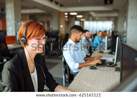 Team of business people working in a call centre on the line.