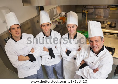 Team of Chef's standing in kitchen