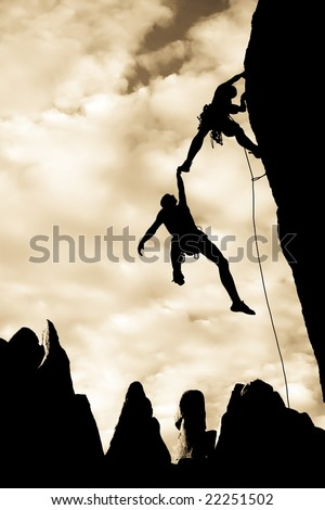 Team of climbers in trouble clinging to a cliff for dear life in The Sierra Nevada Mountains, California.