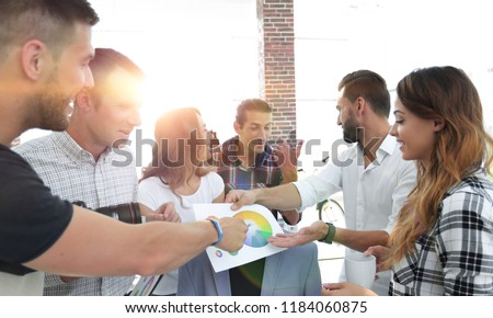 team of designers discussing the color palette #1184060875