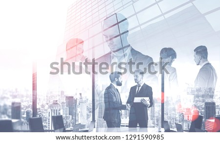 Team of diverse managers working with gadgets and documents over skyscraper background with double exposure of meeting room. Concept of CEO work. Toned image double exposure