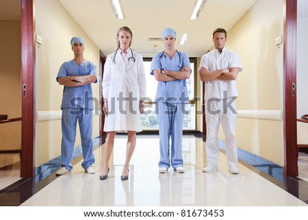 Team of doctor and nurse standing in hallway of hospital