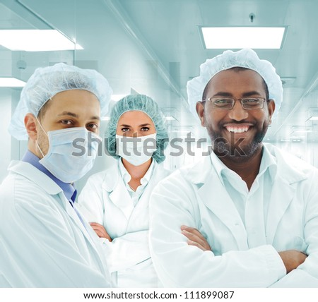 Team of doctors in modern hospital lab