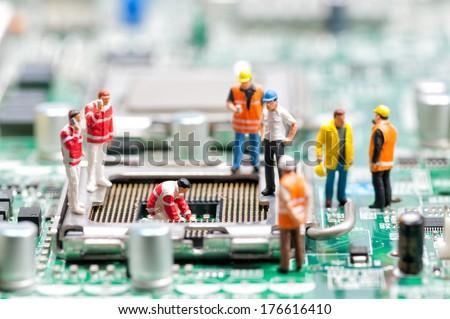 Team of engineers repairing circuit board. Computer repair concept