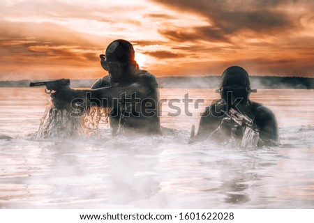 Team of fighters of a special unit move on water to complete the task. The concept of instability, military operations, the cold war. Mixed media