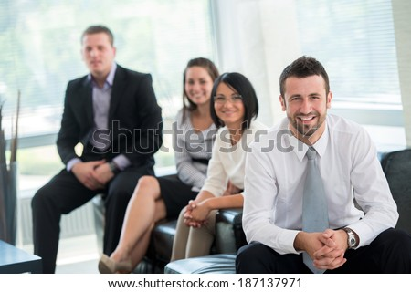 Team of happy successful business people posing