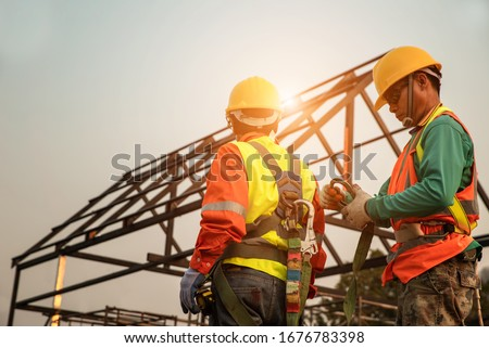 Team of Home Construction Builder checking the safety equipment.Before starting to work on the construction site,.safety first concept image ストックフォト ©