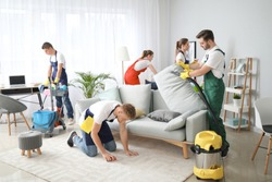 Team of janitors cleaning room