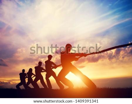 Team of people pulling line together. Tug of war. Concepts of teamwork, business competition etc. 3D Illustration