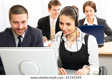Team of people working with headsets on in a call center
