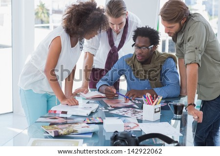 Team of photo editors having brainstorming session in their office