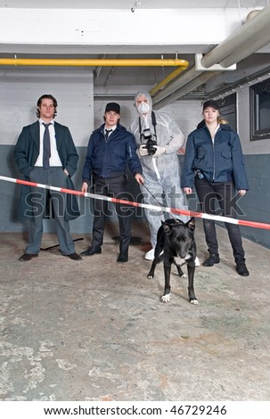 Team of policemen, detective and forensics expert at a crime scene.