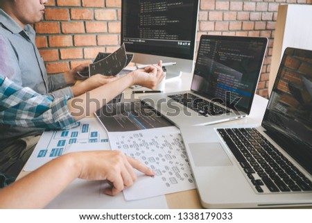 Team of Professional Developer programmer cooperation meeting and brainstorming and programming in website working a software and coding technology, writing codes and database. #1338179033