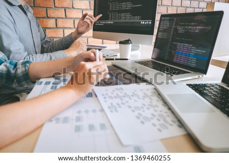 Team of Professional Developer programmer cooperation meeting and brainstorming and programming in website working a software and coding technology, writing codes and database.